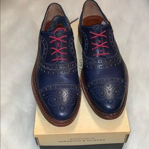 Johnston & Murphy navy calfskin cap toe shoe